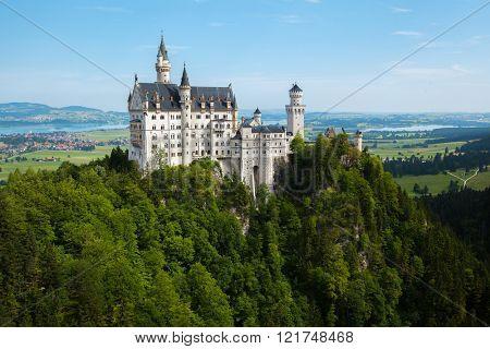Neuschwanstein castle with green forest around