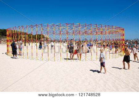 COTTESLOE,WA,AUSTRALIA-MARCH 12,2016:  Red and yellow pole and ribbon sculpture at the interactive public arts festival
