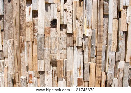 Man made rustic brown wood surface with a rough texture and vertical segmented lines.