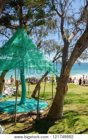 COTTESLOE,WA,AUSTRALIA-MARCH 12,2016:  Tree weaving at the interactive free public arts festival