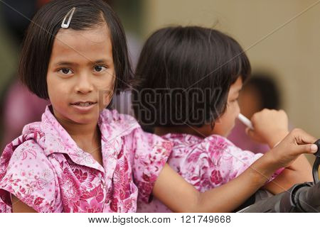 SATUN, THAILAND, DECEMBER 09, 2011 : Portrait of Thai little girl in a social school orphanage in Satun, Thailand,