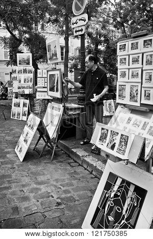 Place du Tertre in Montmartre with street artist,  Paris France October 23, 2012. Montmartre, Paris, France.