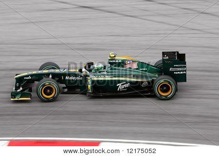 KUALA LUMPUR - APRIL 4: Lotus Racing driver Heiki Kovalainen takes turn 15 on race day at the 2010 Petronas Malaysia Grand-Prix on April 4, 2010 in Sepang International Circuit, Malaysia.