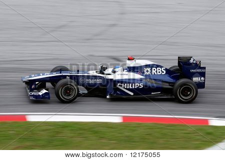 KUALA LUMPUR - APRIL 4: Williams team driver Rubens Barrichelo takes the hairpin turn on race day at the 2010 Petronas Malaysia Grand-Prix on April 4, 2010 in Sepang International Circuit, Malaysia.