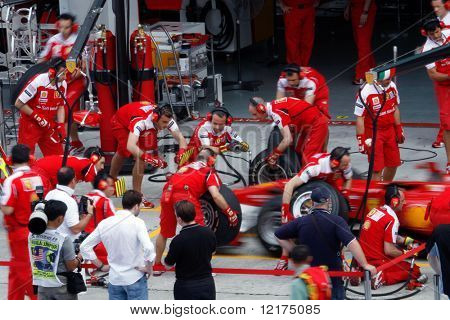 KUALA LUMPUR - APRIL 2: Ferrari pit-crew practices tire change on practice day at the 2010 Petronas Malaysia F1 Grand-Prix on April 2, 2010 in Sepang, Malaysia.