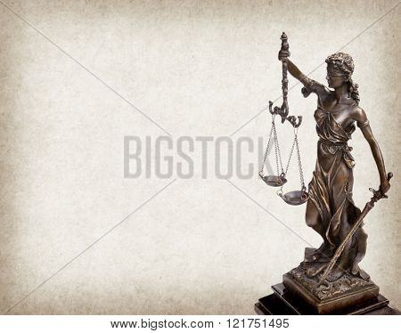 Statue of justice on old paper background, law concept