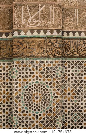 carved Islamic calligraphy and tile work in the 14th century Bou Inania medrese in the ancient medina of Fes, Morocco