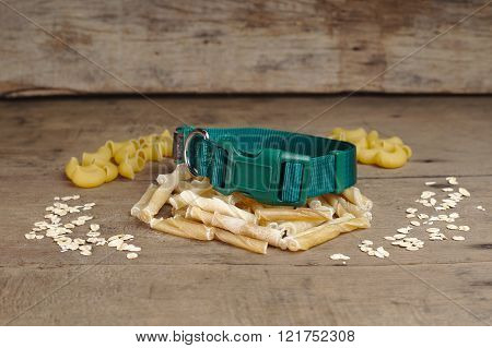 collar and dog bone on wooden background. it is snack for dog