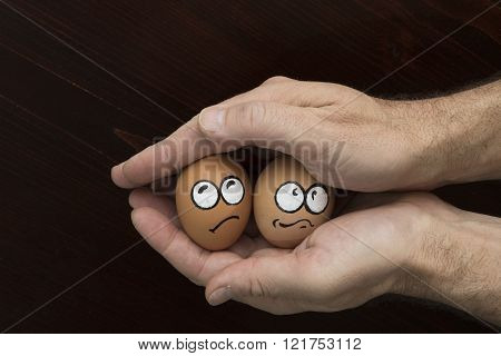 Frightened Egg Face In Man Hand