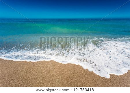 Soft Sea Ocean Waves Wash Over Golden Sand Background. Sand beac