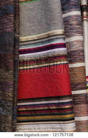 hand woven wool and silk colorful striped textiles in Fes, Morocco