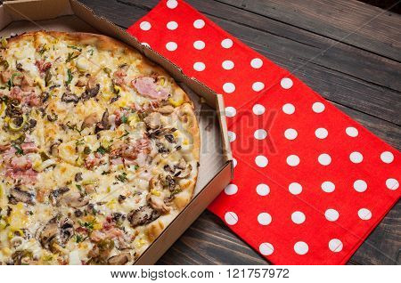 Pizza In Box On Wooden Table Closeup