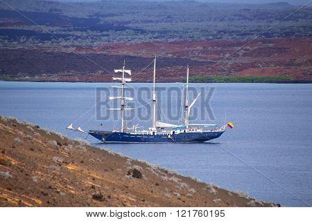 GALAPAGOS, ECUADOR - APRIL 20: Big sailboat anchored between Bartolome and Santiago islands on April 20, 2015 in Galapagos National Park, Ecuador. This park is a UNESCO World Heritage Site