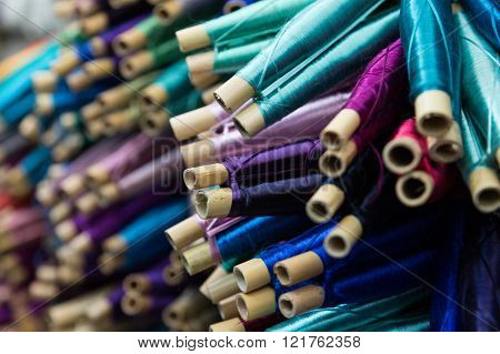 spools of colorful silk thread used for decorating Moroccan caftans in the ancient medina of Fes, Morocco