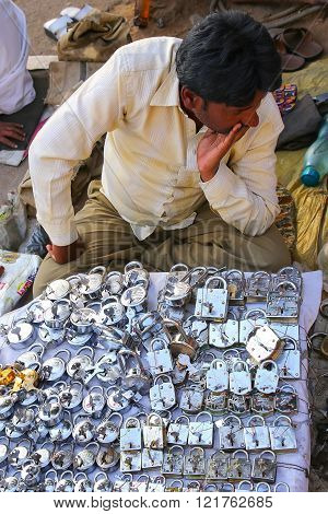 JAIPUR, INDIA - NOVEMBER 15: Unidentified man sells padlocks at the street market on November 15, 2014  in Jaipur, India. Jaipur is the capital and the biggest city of the Indian state of Rajasthan.