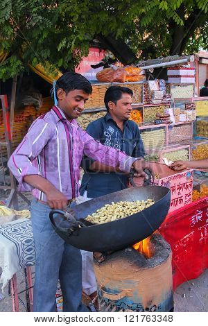 Jaipur, India - November 15: Unidentified Man Roast Peanuts At Street Market On November 15, 2014 In