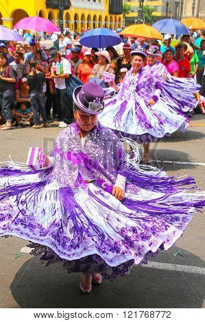 LIMA, PERU-JANUARY 31: Unidentified women perform during Festival of the Virgin de la Candelaria on January 31,2015 in Lima, Peru. Core of the festival is dancing performed by different dance schools