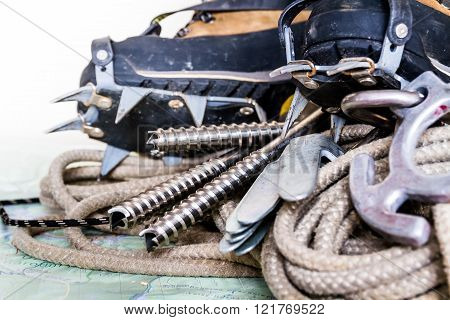 Professional Climbing Gear - Rope, Ice Screws, Crampon  Hobnailed Boots On.