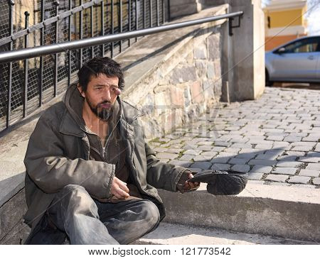 Homeless man on the street of the city. Neurofibromatosis. Three-dimensional skin formation