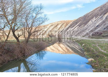 hills reflected in river water