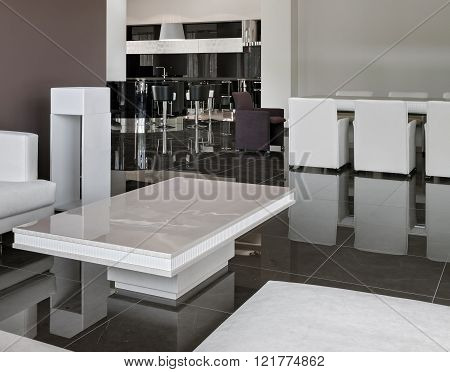Modern Interior With Big Table, Chairs And Living Room In Daylight