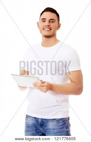 Young handsome man using tablet