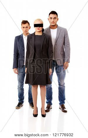 Business team-two man and blindfolded woman