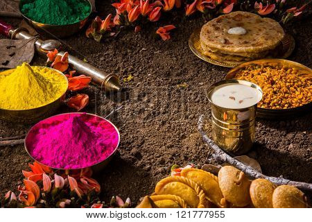 holi festival food with colours, indian festival holi, samosa, kachori, laddu, gujiya, palash flower