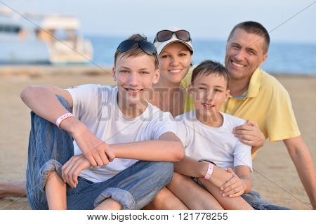 Family at beach in summer