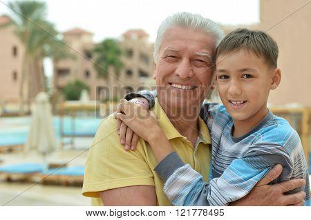 senior man with grandchild at vacation resort