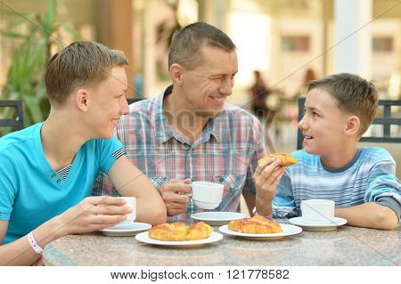 Man and two boys having breakfast