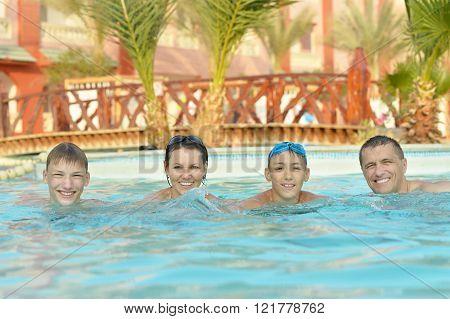 Happy family having  in pool