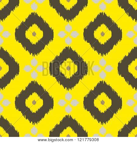 Ikat geometric seamless pattern. Yellow and brown collection.