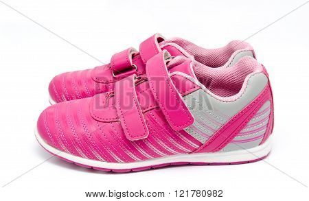 Children pink sport shoes isolated on a white