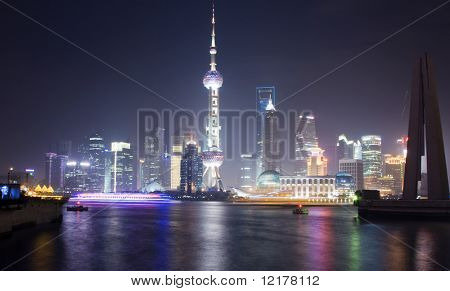 SHANGHAI - MAY 7: Shanghai skyline with the Pearl Tower lightened in the national colors during EXPO 2010 on May 7, 2010 in Shanghai, People's Republic of China.