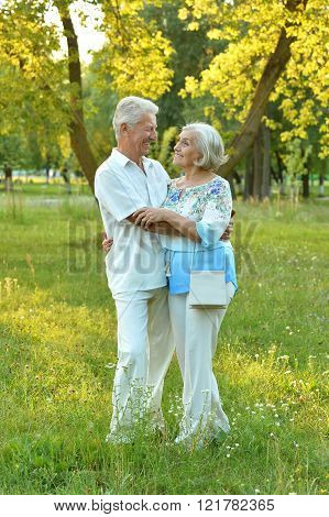 Mature couple on  walk  in summer