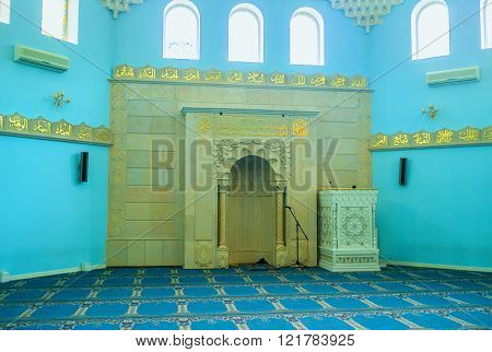 ODESSA UKRAINE - MAY 18 2015: The interior of Al Salam mosque with stone mihrab and minbar on May 18 in Odessa.