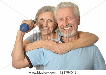 Senior Couple Standing With Dumbbells