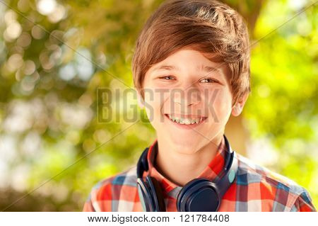Smiling teen boy outdoors