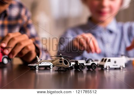 Two children with toy cars.