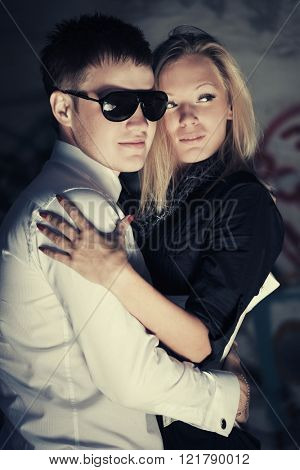 Happy young couple in love at the grungy wall