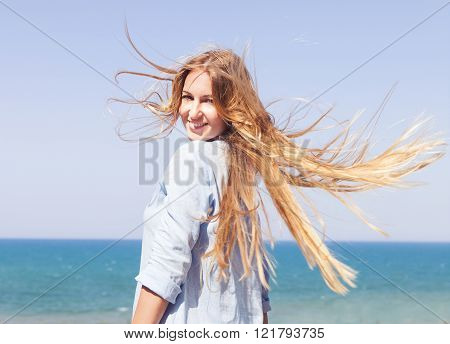 Young Blonde Woman On The Background Of The Ocean