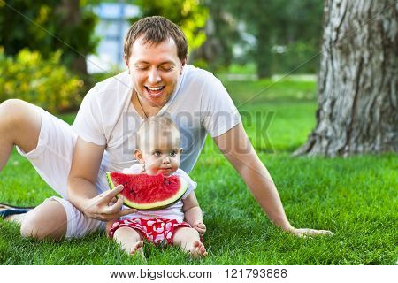 Happy Father With Baby Daughter Outdoors In Summer Park