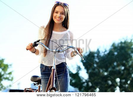 young woman and bike in city
