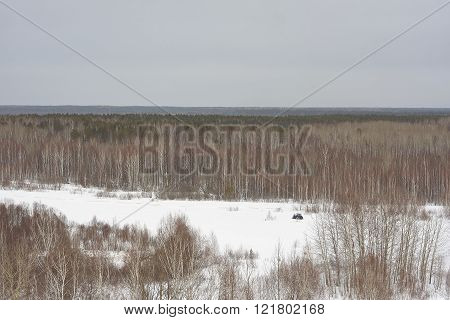 tractor on snowy field from high