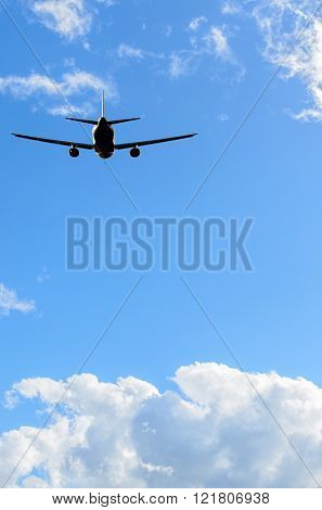 flight of the airplane (jet) over beautiful blue sky with white clouds