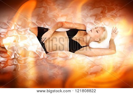 A young blonde woman laying in flames.