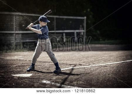 Boy up to bat at a baseball game