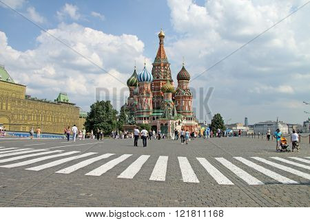 Moscow, Russia - June 11, 2010: Pedestrian Crossing In Front Of St. Basil's Cathedral On Red Square,