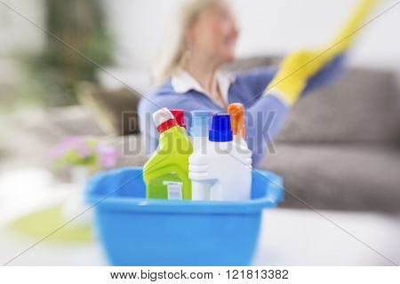 Woman from cleaning service prepare cleaning products for cleaning house